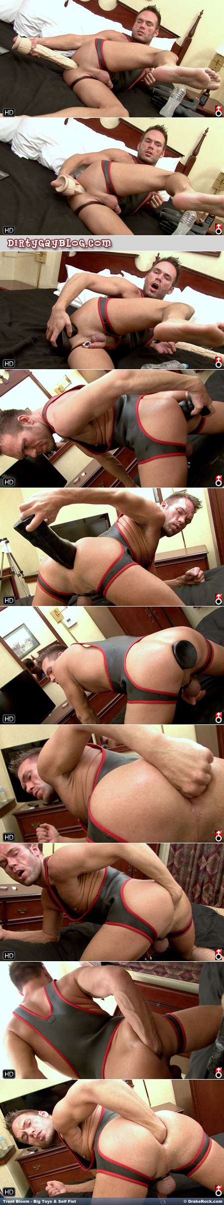 Man in a rubber singlet is able to be fucked by giant dildoes and his own fist in his ass.