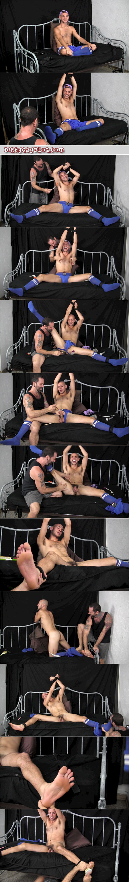 Attractive athlete has his hands tied above his head and is tickled all over in his athletic shorts, jock and socks.