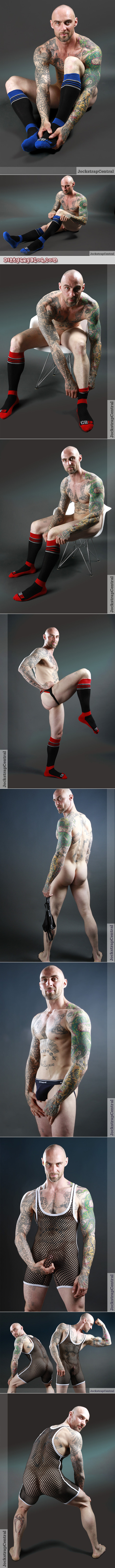 Muscular man with a shaved head and lots of tattoos modeling new and unusual jockstraps, underwear and OTC athletic socks.