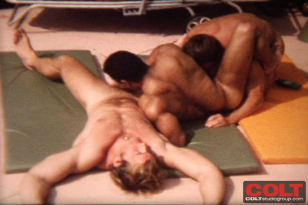 Daisy chain of three hairy muscle men sucking dick by the pool.