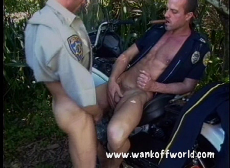 Two muscular cops cumming on each other.