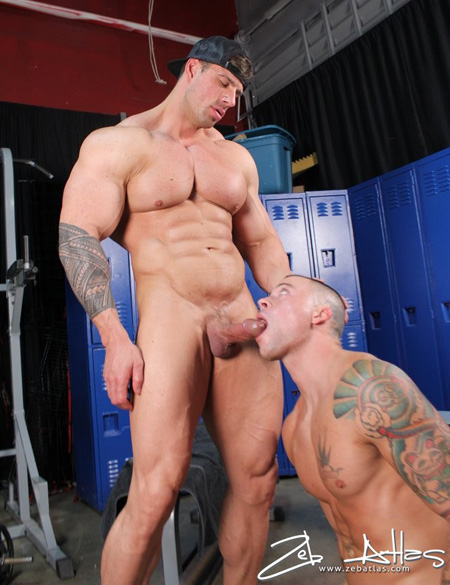 Huge muscle man shooting his load in another guy's mouth.