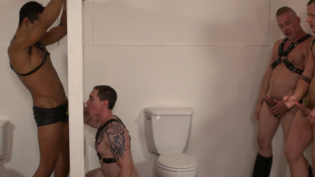 Leather men cruising and using a popular gloryhole.