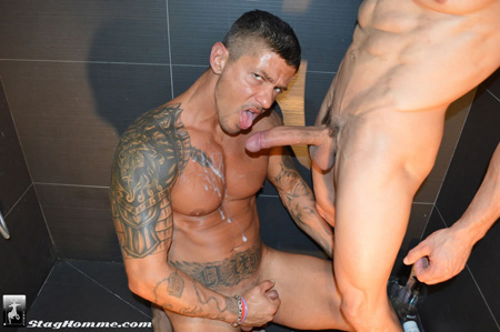 Muscular inked Latino covered in cum from his buddy's huge penis.