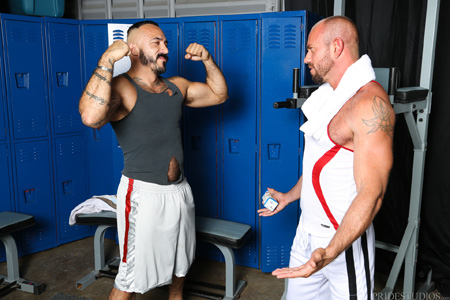 Hairy muscle men comparing their bodies in the locker room.