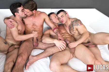 Naked muscle men having a gay sex party.