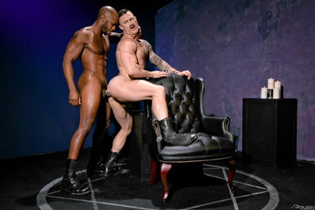 Black muscle stud fucking a white leather guy in his muscular butt.