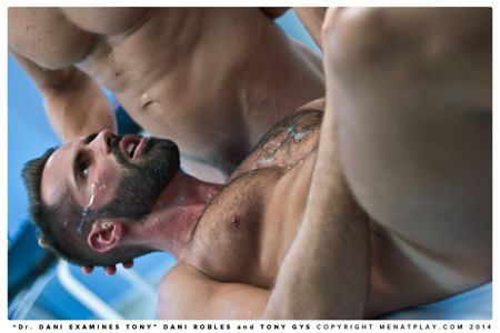 Bearded, muscular man with a cum facial.