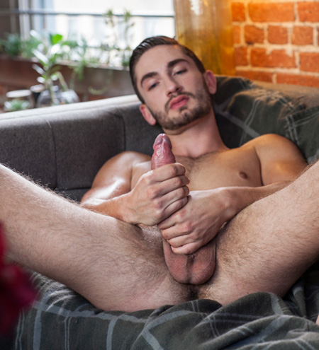 His huge cock is so big he uses both hands at the same time to jerk off.