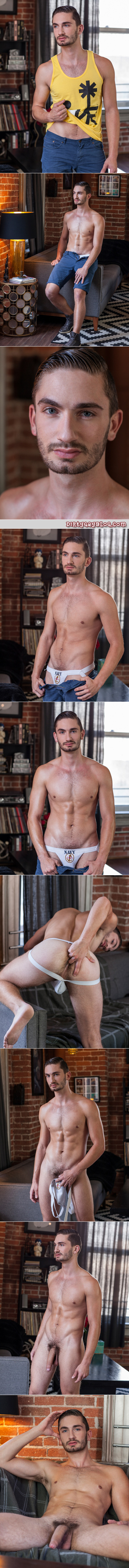 Scruffy young guy in a jockstrap exposing his enormous white dick.