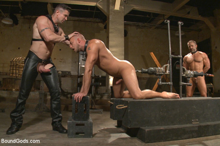 Man in leather bondage getting fucked in the ass by a fucking machine.