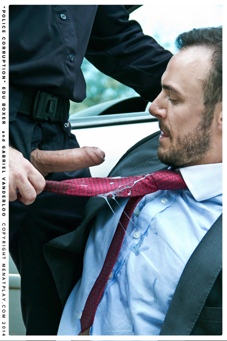 Businessman's necktie covered in cum from a hung, uncut police officer.