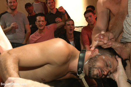 Multiple men cumming on the face of a gay submissive.