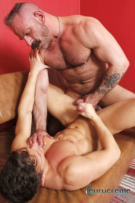 Muscle Daddy with a curled mustache fucking smooth young muscleman  and cumming.
