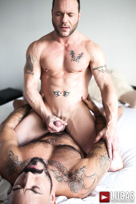 Muscle boy cumming on his Daddy's chest hair.