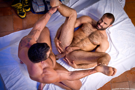 Beefy muscle bear on his back being fucked by a macho stud with a thick uncut cock.