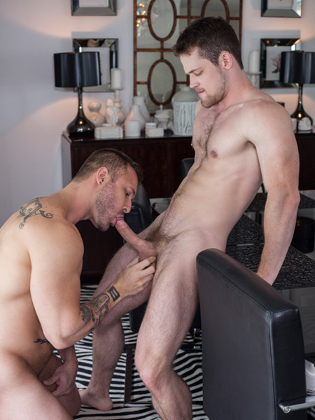 Beefy muscle stud sucking a hung top's dick.