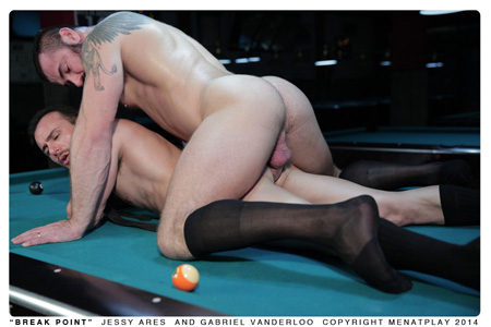 Beefy man in OTC dress socks fucking another guy doggy style on the pool table.