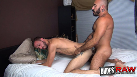 Hairy muscle bear fucking a younger man and breeding his asshole.