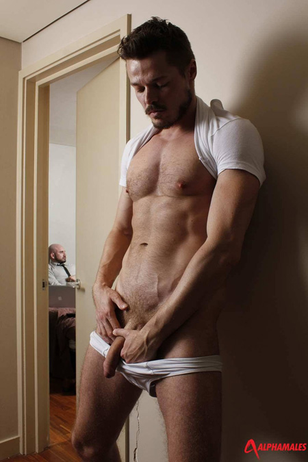 Gay voyeur masturbating outside another man's hotel room who is jacking off to porno websites..