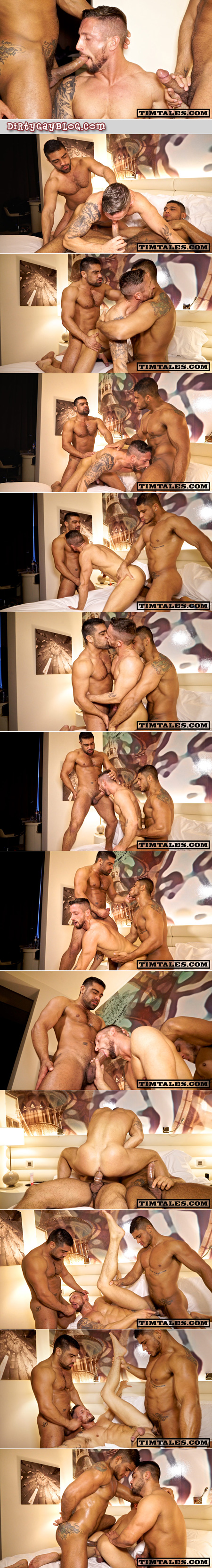 Two Brazilian muscle studs spit-roast a bearded white muscle stud covered with tattoos.