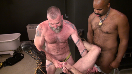 Fit, bearded leather grandpa in a jockstrap cumming in another guy's ass.