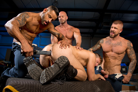 Three muscular guards catch a dildo thief and gang bang him.