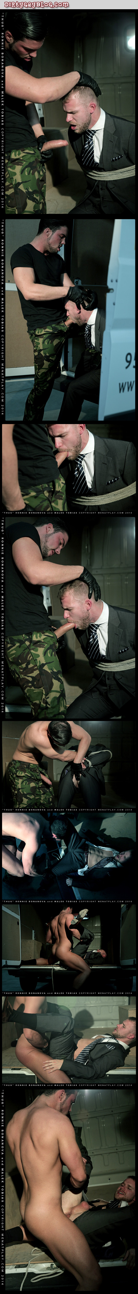 Sexy blonde businessman is forced to suck big uncut military man's cock before being fucked by him through his torn suit.