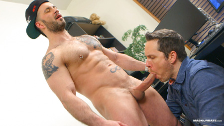 Muscle stud shooting his load into another man's mouth.