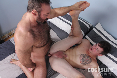 Bear Daddy barebacking a smooth young man.