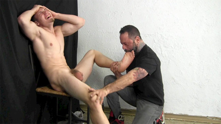 Straight 21-year-old muscle stud with huge balls getting his feet sucked by another man.