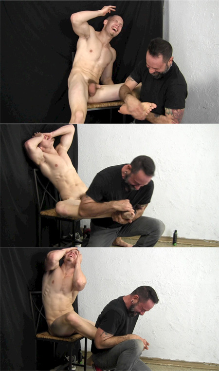 Straight nude muscle hunk goes crazy when another man tickles his big feet.