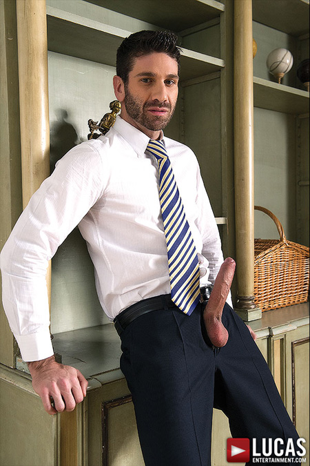 Hunky businessman with a huge uncut erection sticking out from his trousers.