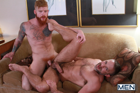 Heavily tattooed muscle ginger fucking a hairy muscle Daddy.