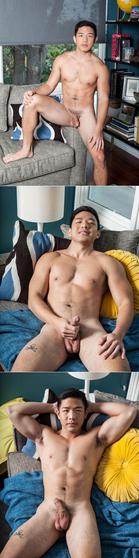 Hairy muscular Asian man grabbing his dick.