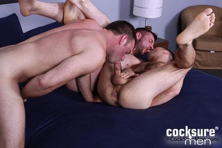 Hairy men in a gay sex 3-way.