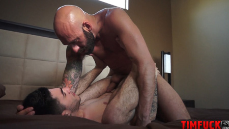 Bald, bearded Daddy with his big dick inside a young man condom-free.