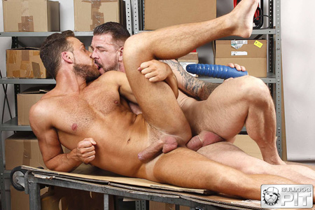 Hung Daddy fucking his bearded co-worker on a shipping table.
