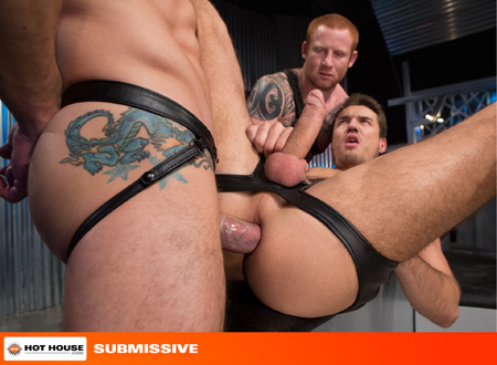 Hung bottom taking a giant cock in his ass while another man watches.
