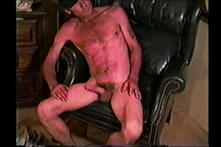 Blue collar man nude with an erection.