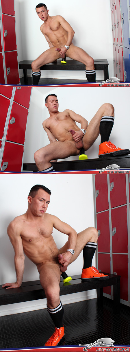 Compact muscle guy sitting on a big dildo in a locker room.
