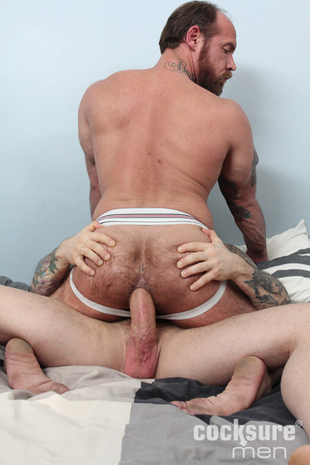Balding, hairy muscle Daddy sitting on a huge cock bareback.