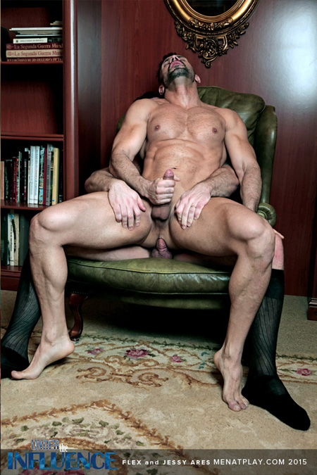 Huge muscle guy sitting on a hard, uncut cock.
