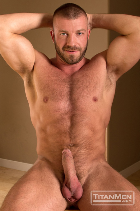 Hairy muscle man with a ginger beard posing nude with an erection.