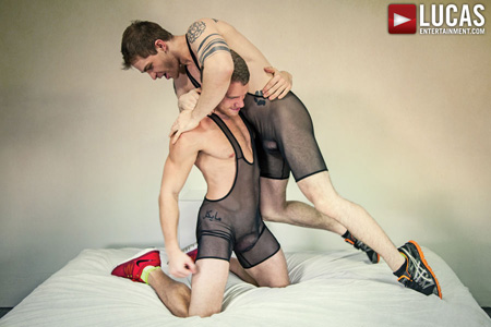 Shredded young studs in sheer wrestling singlets wrestle with hard-ons.