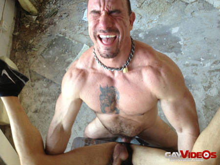 Giant muscle Daddy making faces at the moment he is orgasming.