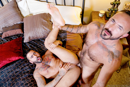 Tattooed muscle Daddy fucking an inked, muscular cub.
