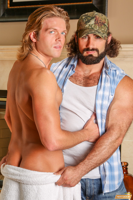 Beefy, hairy, bearded trucker sidles up to a smooth blonde man in nothing but a towel.