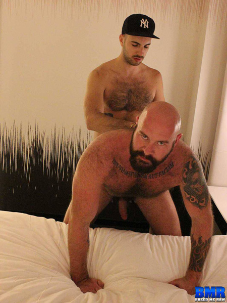 Muscle bear taking a raw cock in his ass from a hairy mustache man.
