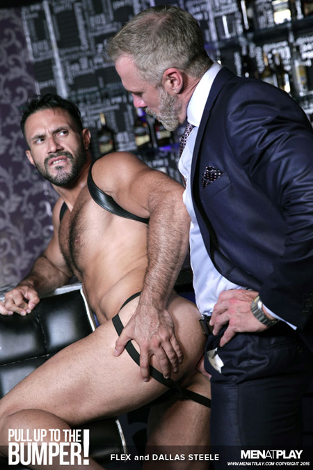 Older businessman in a suit fucking a hairy, muscular Latino leather bartender.